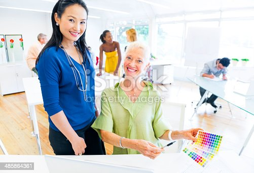 487670635istockphoto Designers Choosing Colors from the Color Swatch 485864361