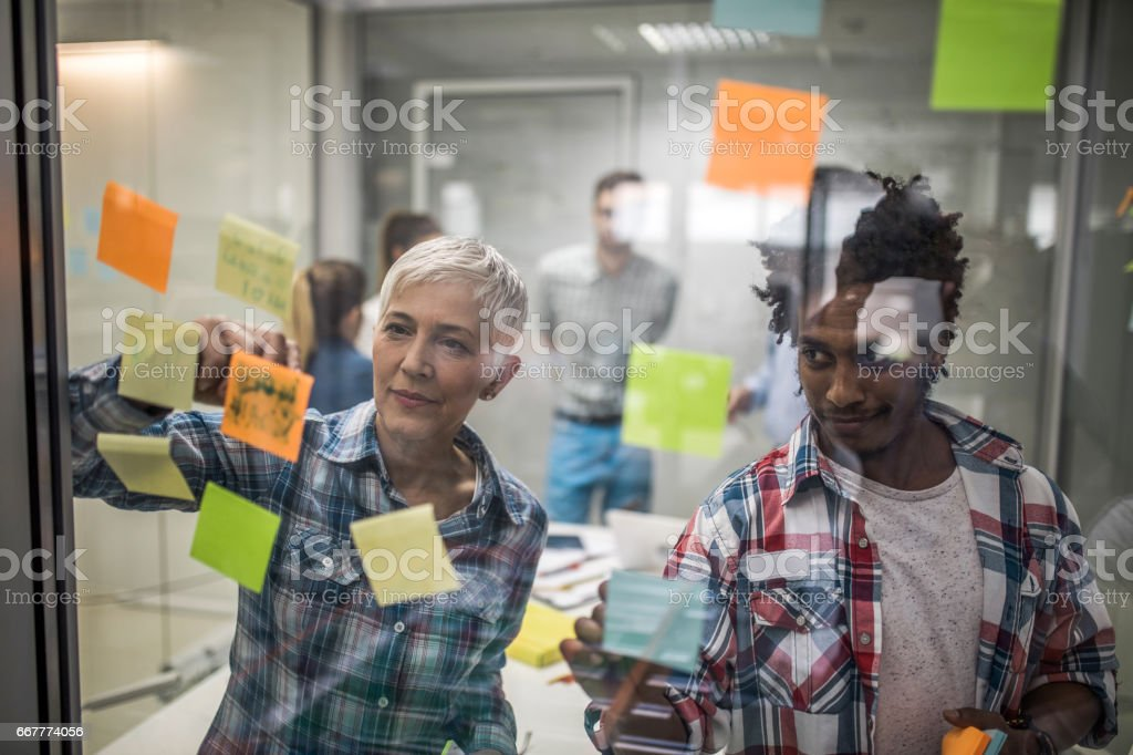 Designers creating a mind map on a meeting in the office. stock photo