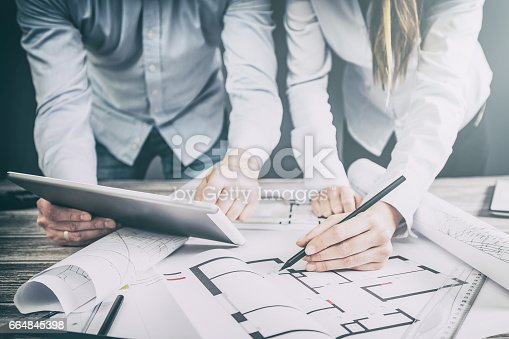istock Designers discuss the sketches inside the house. 664845398