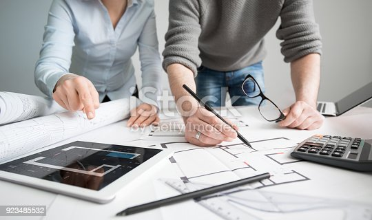 832105172 istock photo Designers discuss the sketches inside the house. 923485532