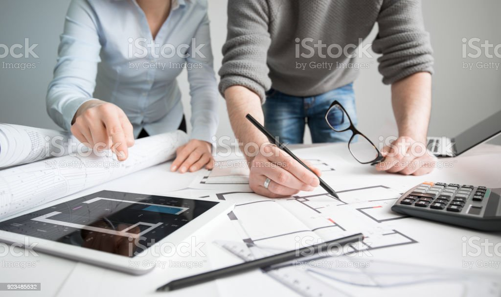 Designers discuss the sketches inside the house. stock photo