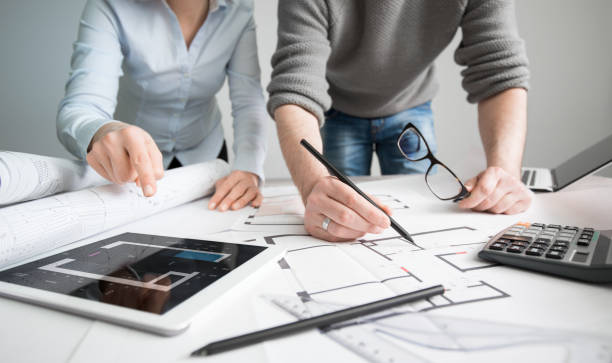 Designers discuss the sketches inside the house. architects architect project interior design designer planning people architecture drawing business plan construction sketch house concept - stock image design occupation stock pictures, royalty-free photos & images