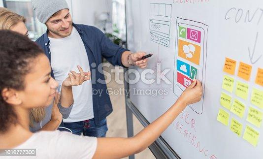 istock Designers drawing website ux app development. 1016777300