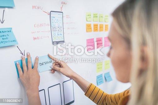 istock Designers drawing website ux app development. 1159039241