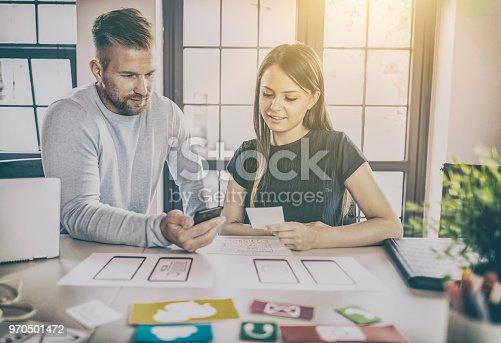 istock Designers drawing website ux app development. 970501472