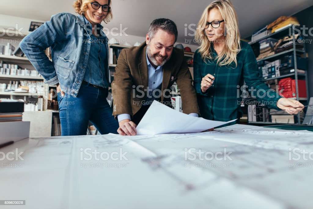 Designers finalize a housing construction plan stock photo