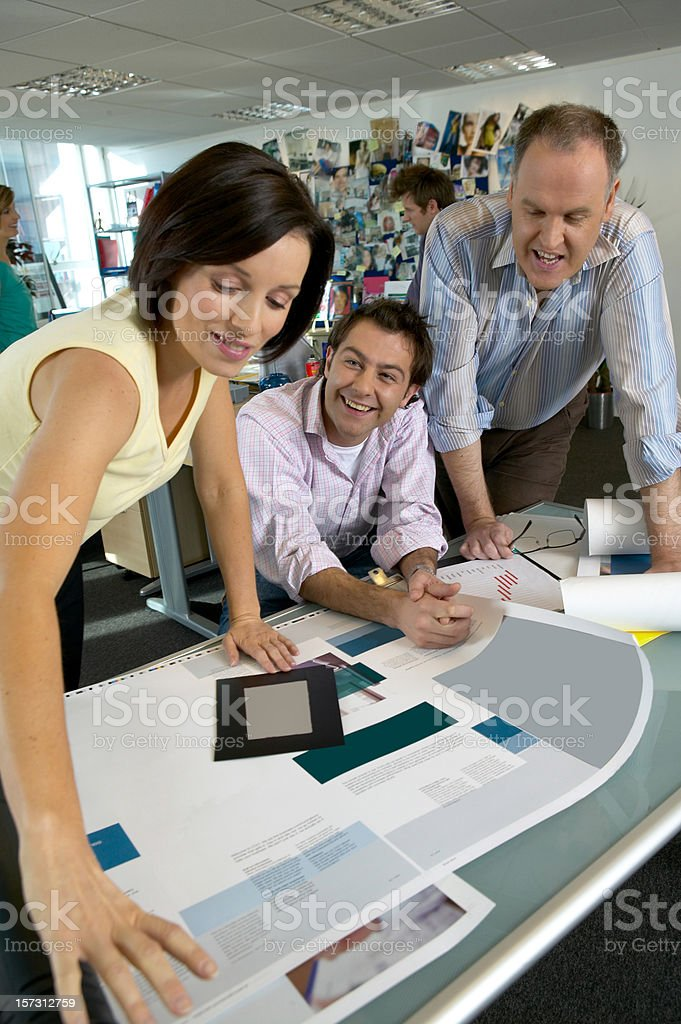 Designers going through current artwork royalty-free stock photo