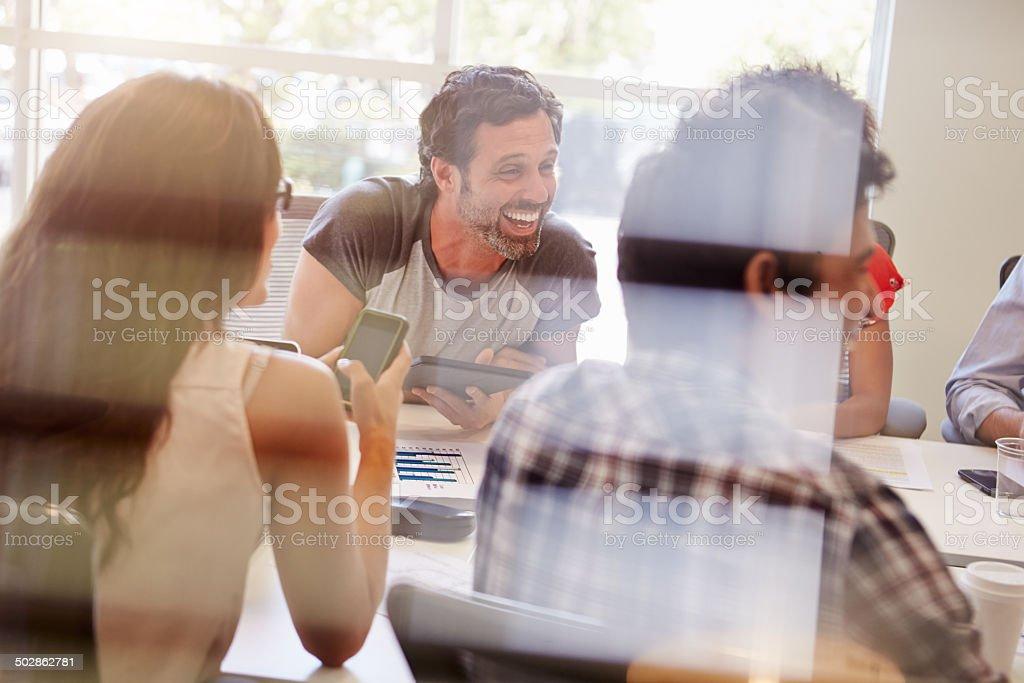 Designers Having Meeting Viewed Through Window stock photo