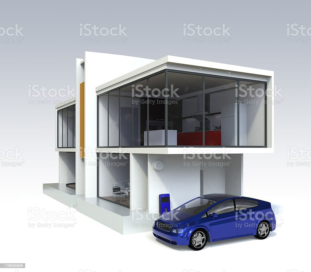 Designer`s house and electric car stock photo