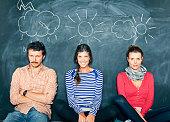 Designers in front of a blackboard