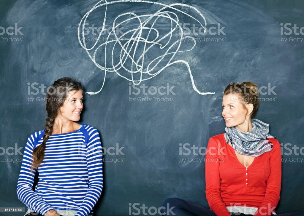 Designers in front of a blackboard royalty-free stock photo