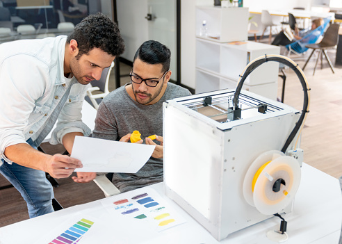istock Designers using a 3D printer at a workshop 1021334598