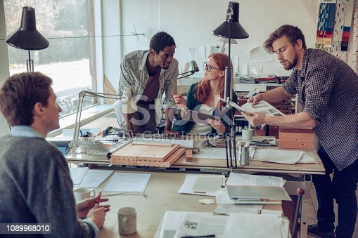 Close up of a group of desginers working on a project