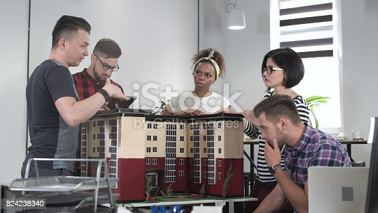 487670635istockphoto Designers working with mockup of house 824238340