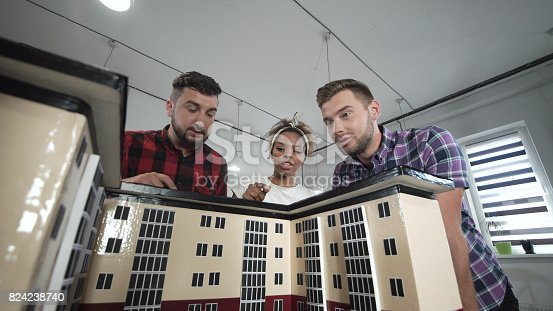 487670635istockphoto Designers working with mockup of house 824238740