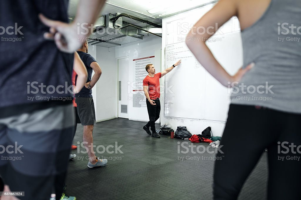 Designing a fitness program to fit their needs stock photo
