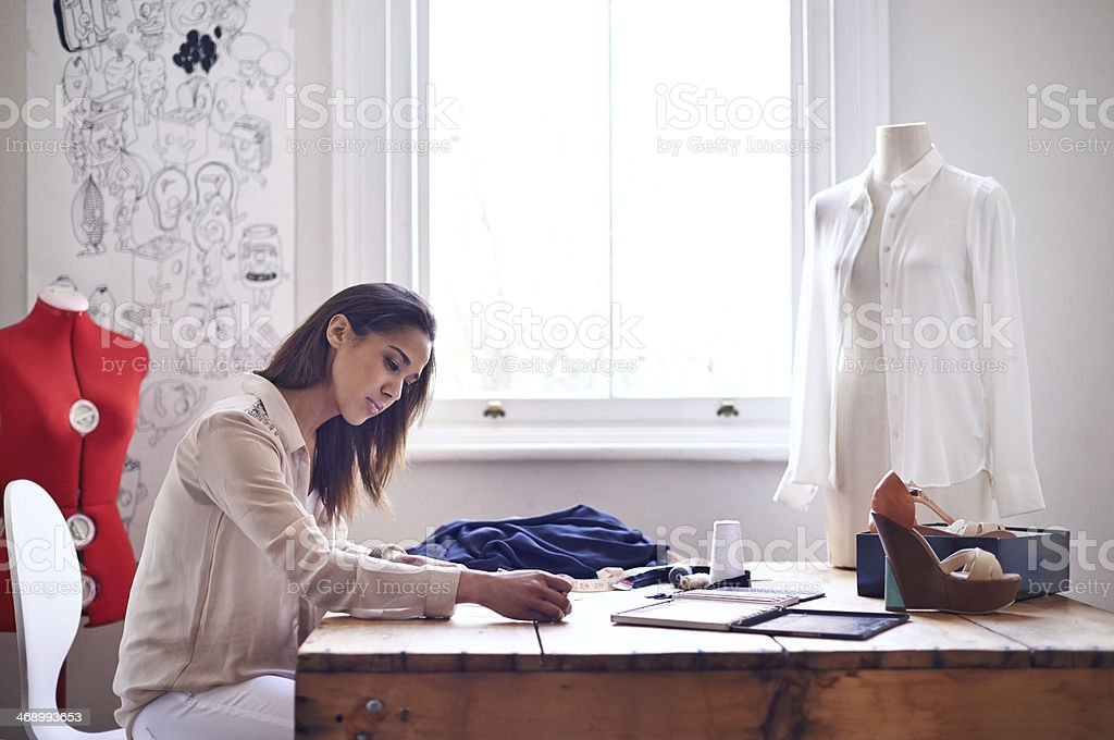 Designing her new clothing line stock photo