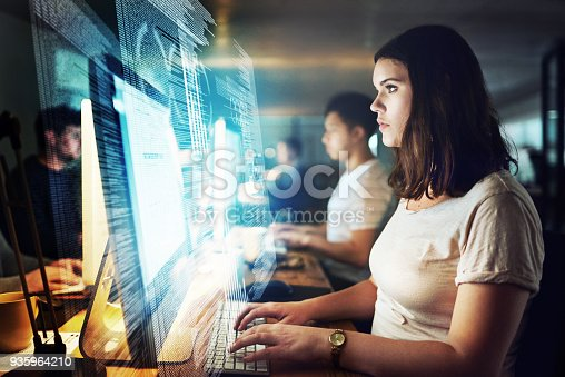 Shot of a programmer working on a computer code at night