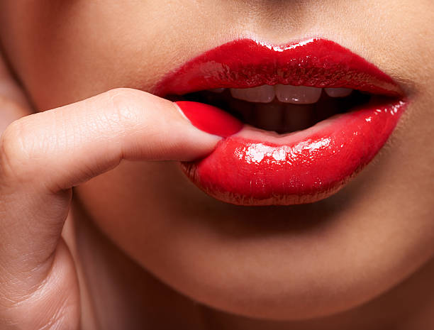 desire comes in red - human lips stock photos and pictures