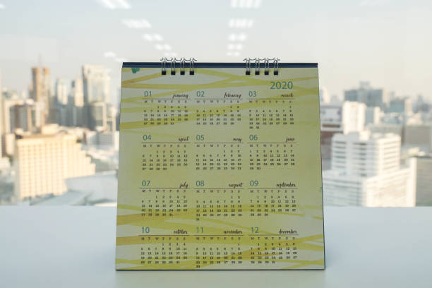 desk 2020 calendar on office table stock photo