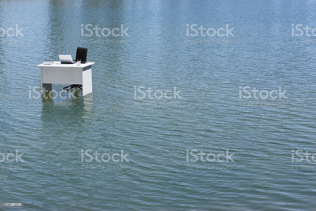 A desk alone in the water stock photo