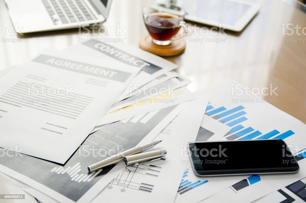 Desk at office in the morning with breakfast and a lot of equipment (Workplace concept) royalty-free stock photo