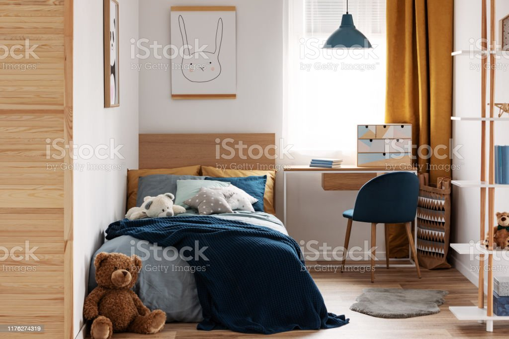 Image of: Desk Chair And Single Bed With Blue Bedding In Cozy Bedroom Interior For Children Stock Photo Download Image Now Istock