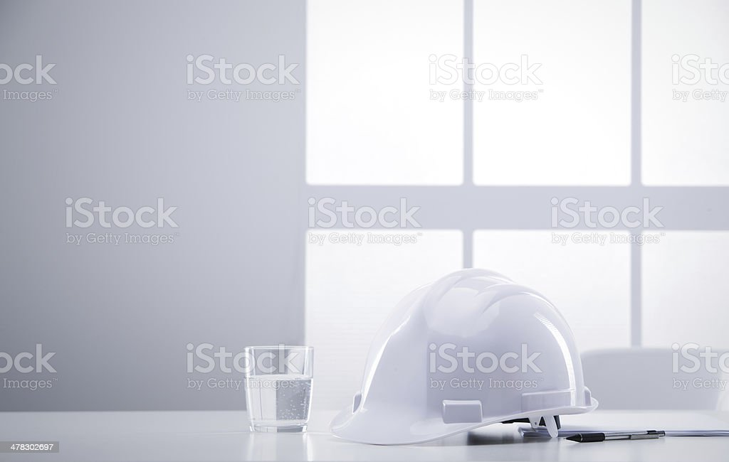 desk engineer with hardhat royalty-free stock photo