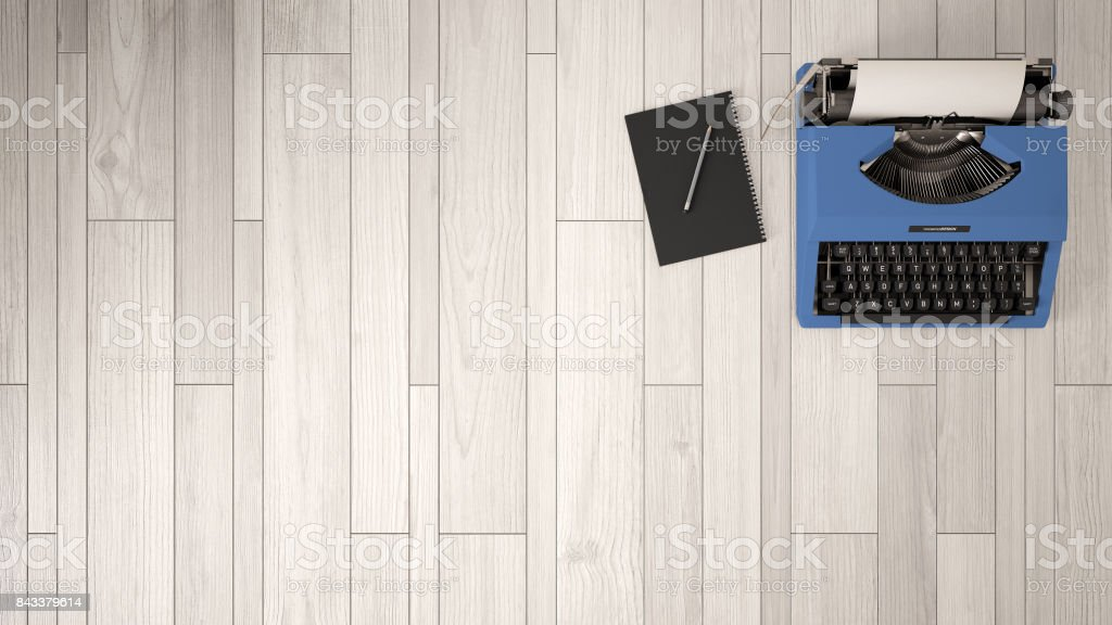 Desk for writer. workplace organization background. Top view with textured table, typewriter and notepad with pencil. White and blue design. stock photo