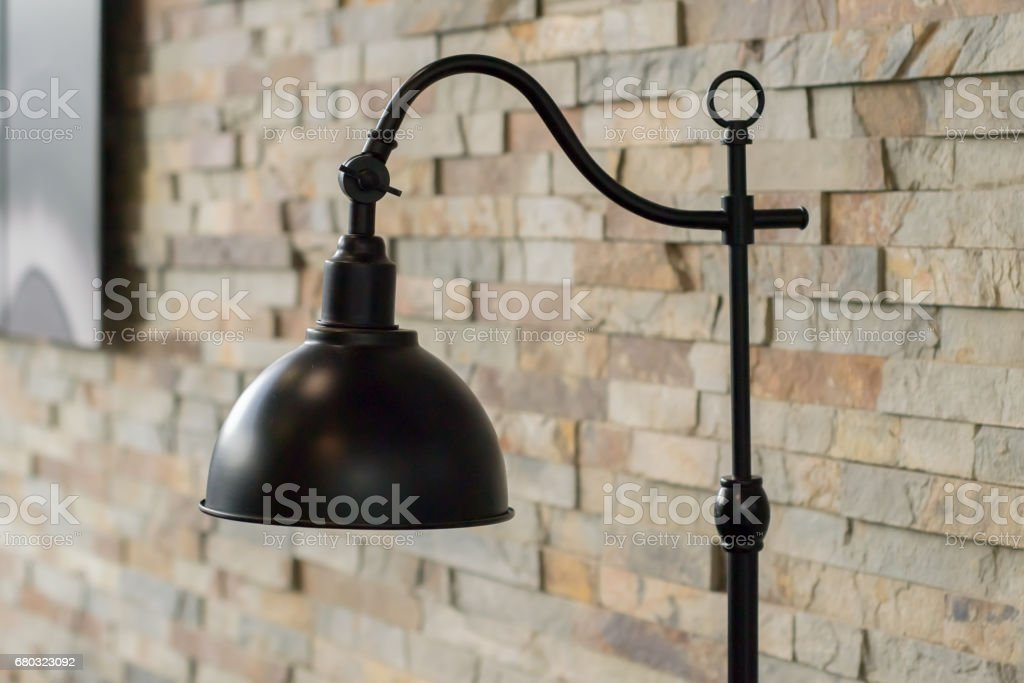 Desk lamp against brick wall stock photo