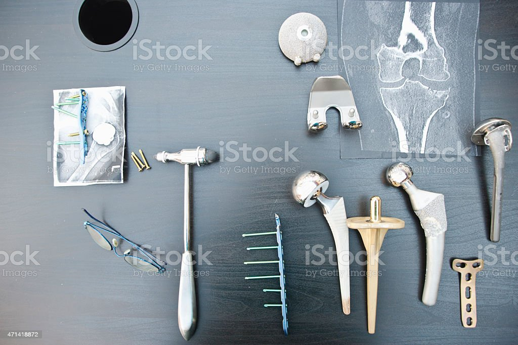 Desk of an orthopedic surgeon with different types of arthroplasties stock photo