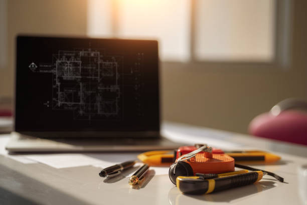 Desk of architects engineer with a blueprint on table in the office. Engineering tools and construction concept. stock photo