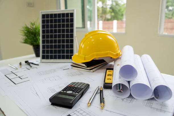 Desk of architects Solar Energy Powered Home Green for reduce global warming. stock photo