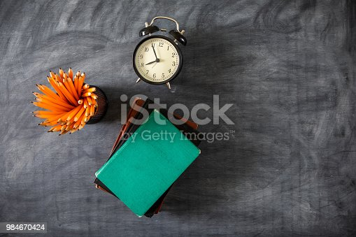istock Desk Of Student, Alarm Clock, Books and Pencils 984670424