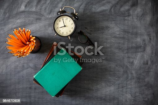 istock Desk Of Student, Alarm Clock, Books and Pencils 984670908
