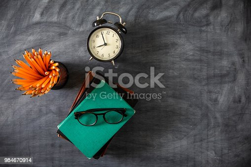 istock Desk Of Student, Alarm Clock, Books and Pencils 984670914
