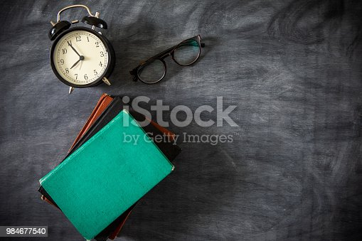 istock Desk Of Student, Alarm Clock, Books and Pencils 984677540