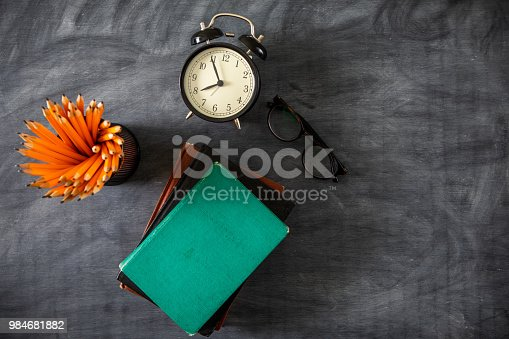 istock Desk Of Student, Alarm Clock, Books and Pencils 984681882
