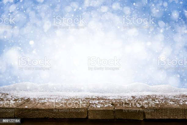 Desk of wood and snow blue blurred background of winter and old picture id869122164?b=1&k=6&m=869122164&s=612x612&h=wzyw1dkytts33w3 kp50fngupxpu1a mdgd9zkpsduq=