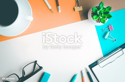 istock Desk office background with supplies.business working table 680646992