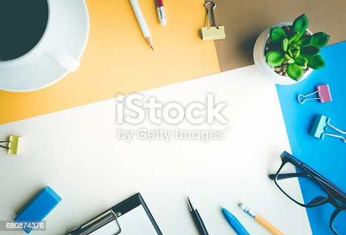 istock Desk office background with supplies.business working table 680874376