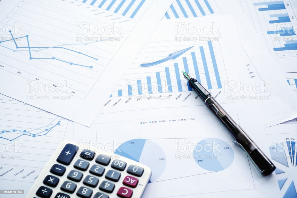 Desk office with pen, analysis report ,calculator. stock photo
