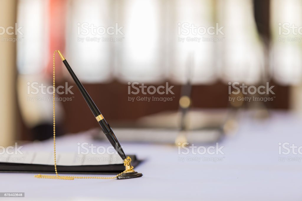 Desk pen stand for signing contracts.With copy space. royalty-free stock photo