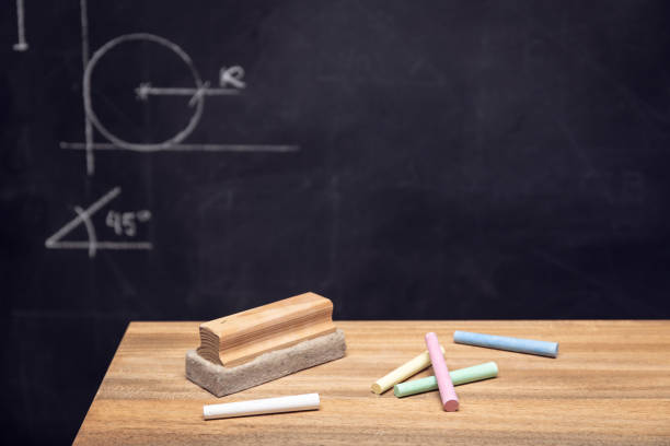 Desk table with chalk, eraser and Blackboard stock photo
