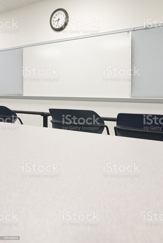 Desk View Of  Empty Classroom With Chairs, Whiteboard, Bulletin Boards royalty-free stock photo
