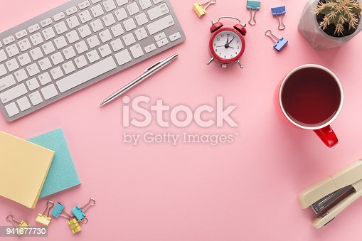 istock Desk with coffee cup and keyboard with copy space 941677730