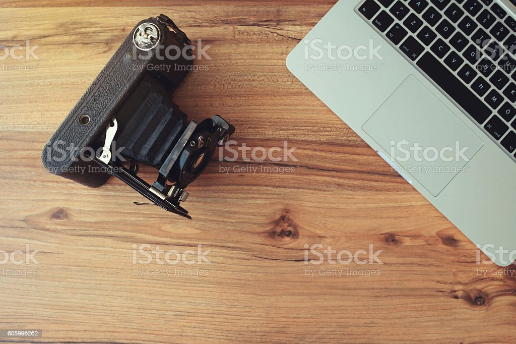 Desk with computer and camera stock photo