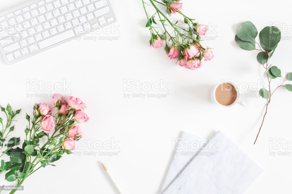 desk with computer rose flowers eucalyptus flat lay top view picture id908048004