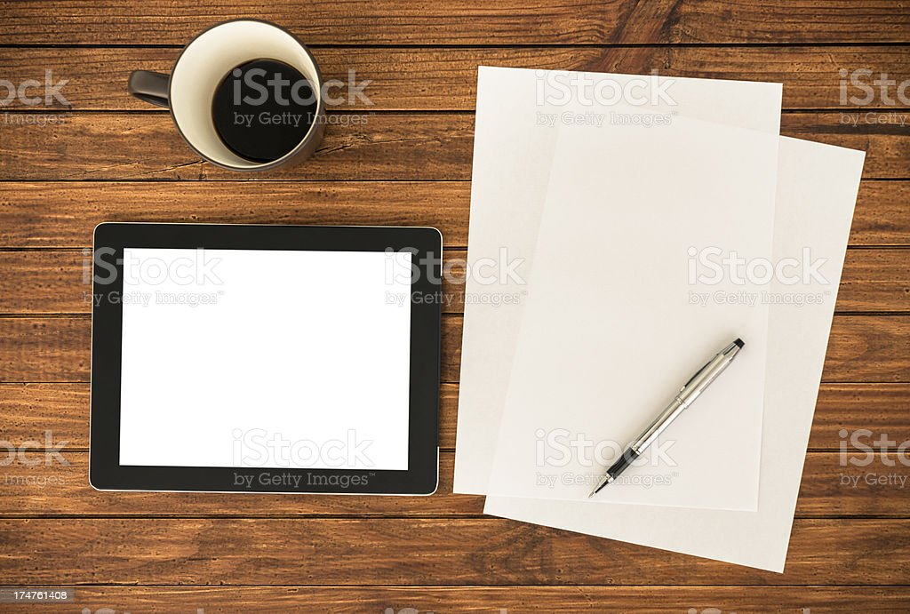 Desk with empty digital tablet royalty-free stock photo