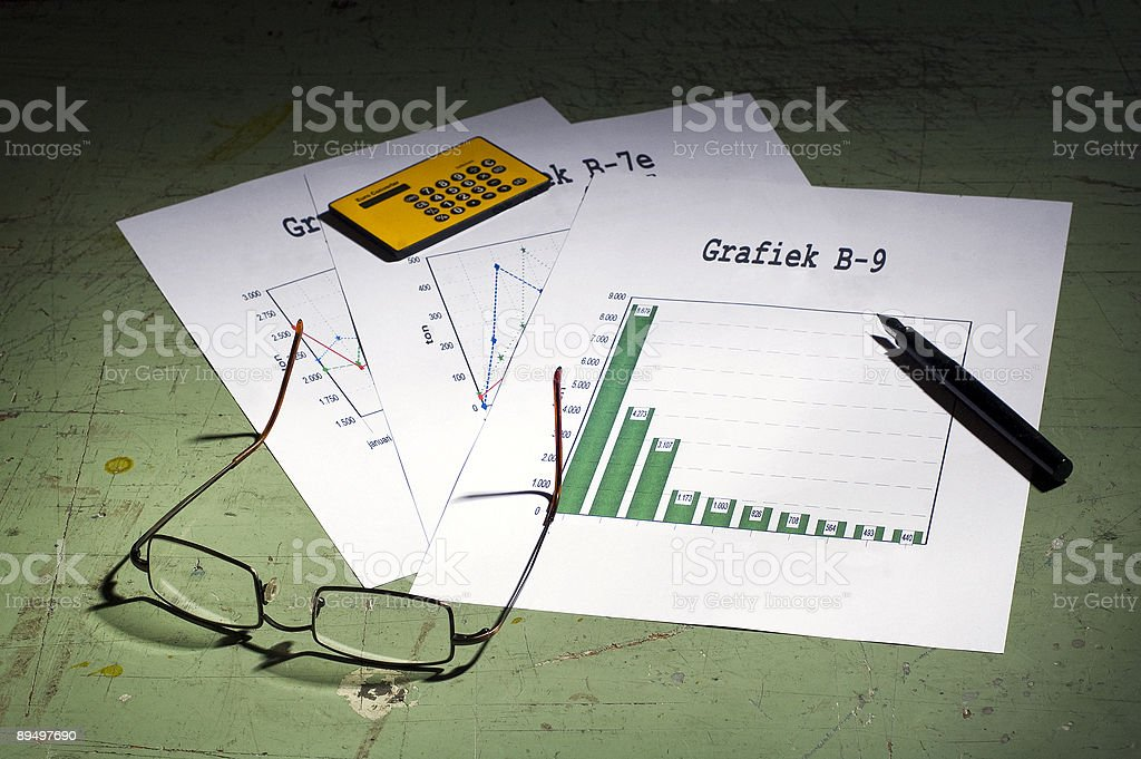 Desk with forms, pen, calculator and glasses royalty free stockfoto